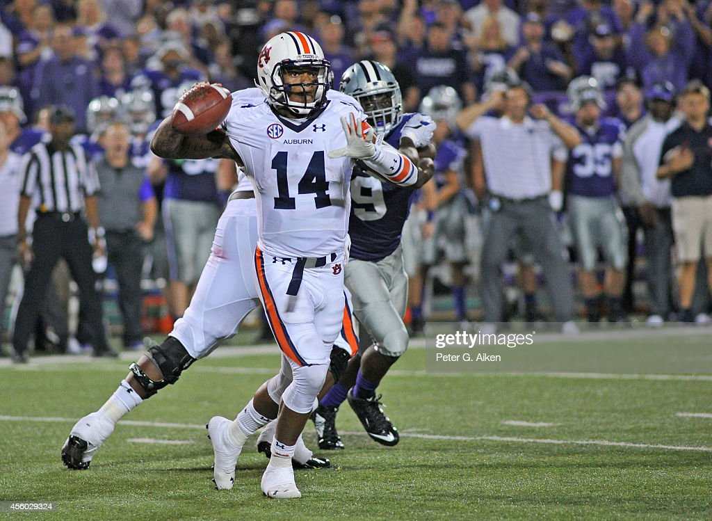 Quarterback Nick Marshall of the Auburn Tigers rolls out on a pass play against the Kansas State Wildcats during the second half on September 18 2014...