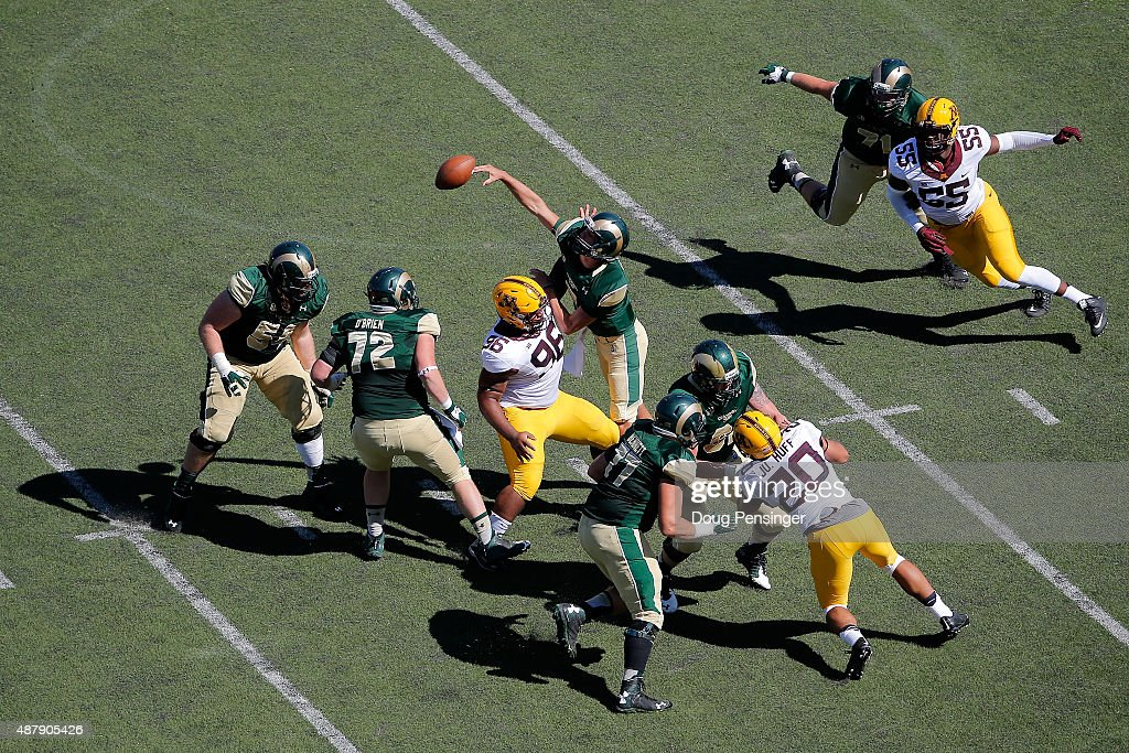 Quarterback Nick Stevens of the Colorado State Rams delivers an incomplete pass against the defense of Steven Richardson of the Minnesota Golden...