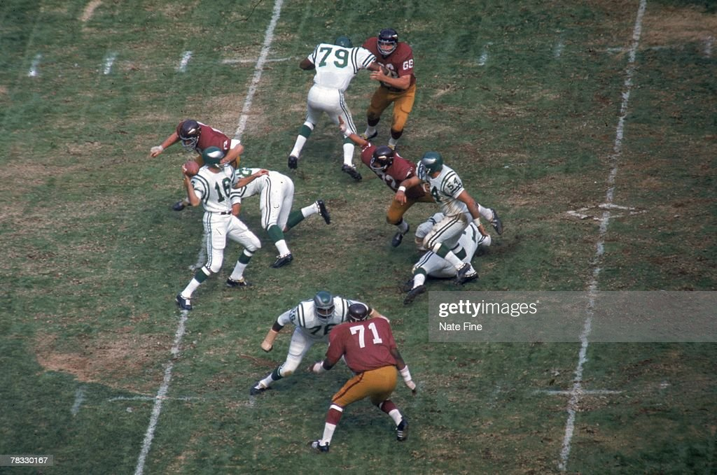 Quarterback Norm Snead #16 of the Philadelphia Eagles drops back to pass against the Washington Redskins at RFK Stadium on October 6, 1968 in Washington, D.C. The Redskins defeated the Eagles 17-14.