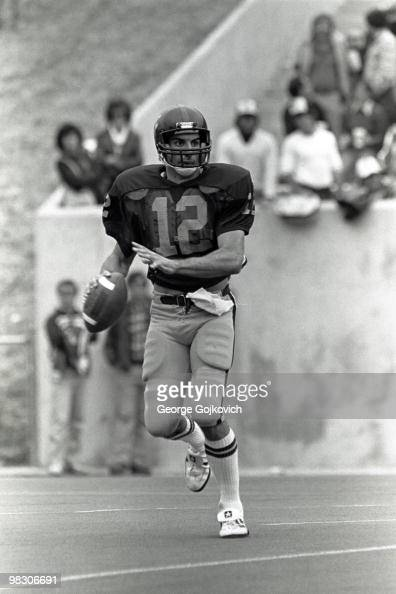 Quarterback Oliver Luck of the West Virginia University Mountaineers looks to pass during a college football game at Mountaineer Field in 1981 in...