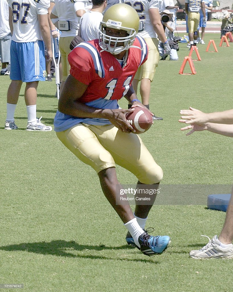 UCLA quarterback Ossar Rasshan hands off during the Blue and White scrimmage held at Drake Stadium August 19 2006 in Westwood California