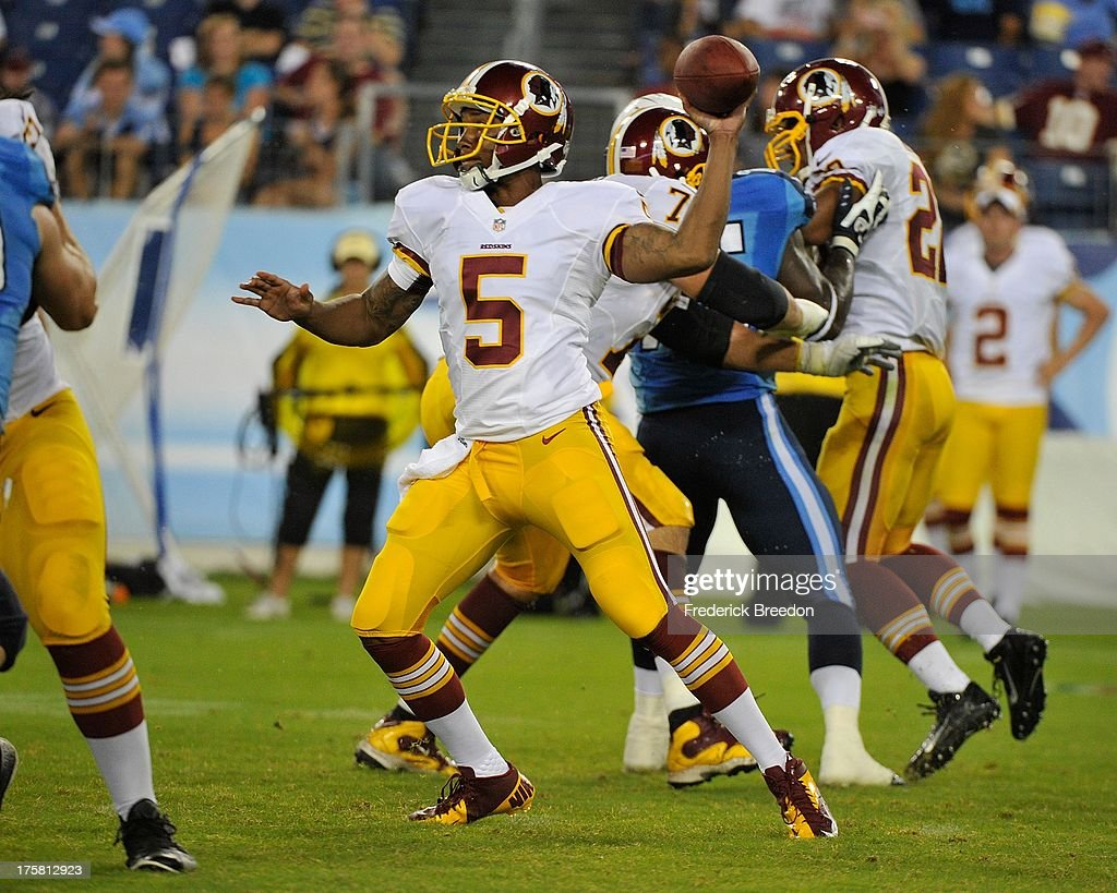 Quarterback Pat White #5 of the Washington Redskins drops back to throw a pass against the Tennessee Titans during a pre-season game at LP Field on August 8, 2013 in Nashville, Tennessee.