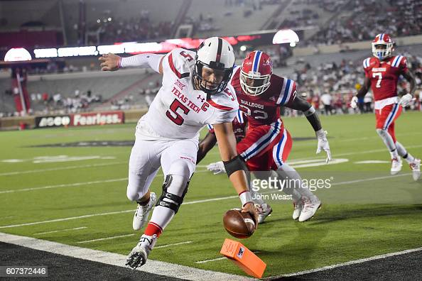 Quarterback Patrick Mahomes II of the Texas Tech Red Raiders reaches for the pylon and scores a touchdown during the game Louisiana Tech Bulldogs on...