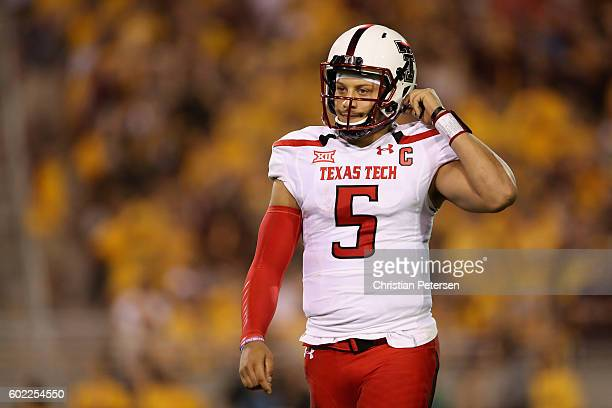 Quarterback Patrick Mahomes II of the Texas Tech Red Raiders reacts as he walks off the field during the first half of the college football game...