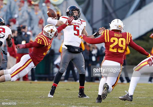 Quarterback Patrick Mahomes II of the Texas Tech Red Raiders throws under pressure from linebacker Josh Jahlas and linebacker Kane Seeley of the Iowa...