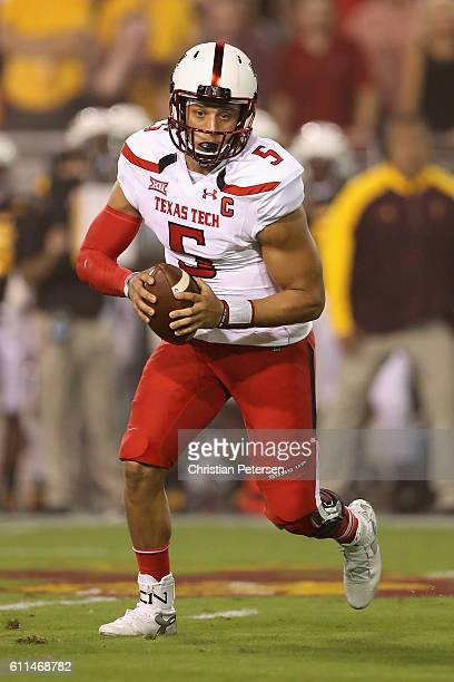 Quarterback Patrick Mahomes II of the Texas Tech Red Raiders scrambles to pass during the college football game against the Arizona State Sun Devils...