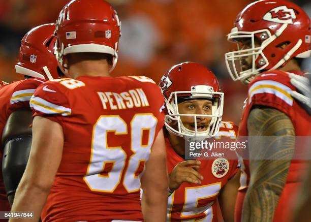 Quarterback Patrick Mahomes of the Kansas City Chiefs calls a play in the huddle against the Tennessee Titans during the first half of a preseason...