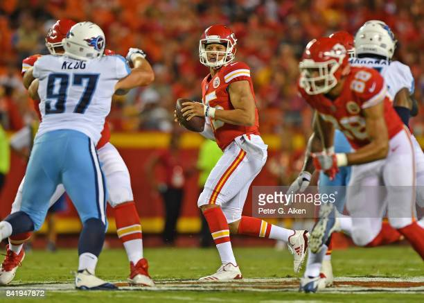 Quarterback Patrick Mahomes of the Kansas City Chiefs drops back to pass against the Tennessee Titans during the first half of a preseason game on...