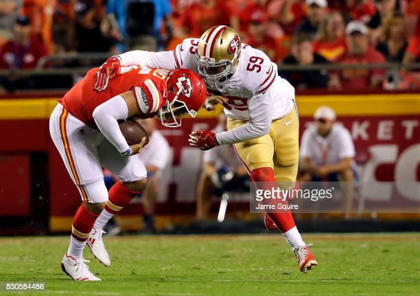 Quarterback Patrick Mahomes of the Kansas City Chiefs is sacked by outside linebacker Aaron Lynch of the San Francisco 49ers during the preseason...