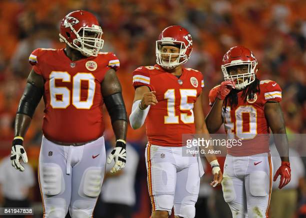 Quarterback Patrick Mahomes of the Kansas City Chiefs looks on with teammates Andrew Tiller and Devine Redding against the Tennessee Titans during...