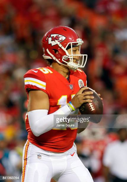 Quarterback Patrick Mahomes of the Kansas City Chiefs looks to pass during the game against the Tennessee Titans at Arrowhead Stadium on August 31...