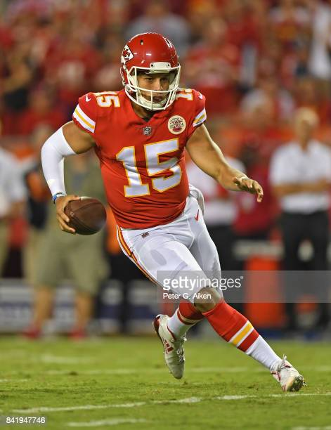 Quarterback Patrick Mahomes of the Kansas City Chiefs scrambles down field against the Tennessee Titans during the first half of a preseason game on...