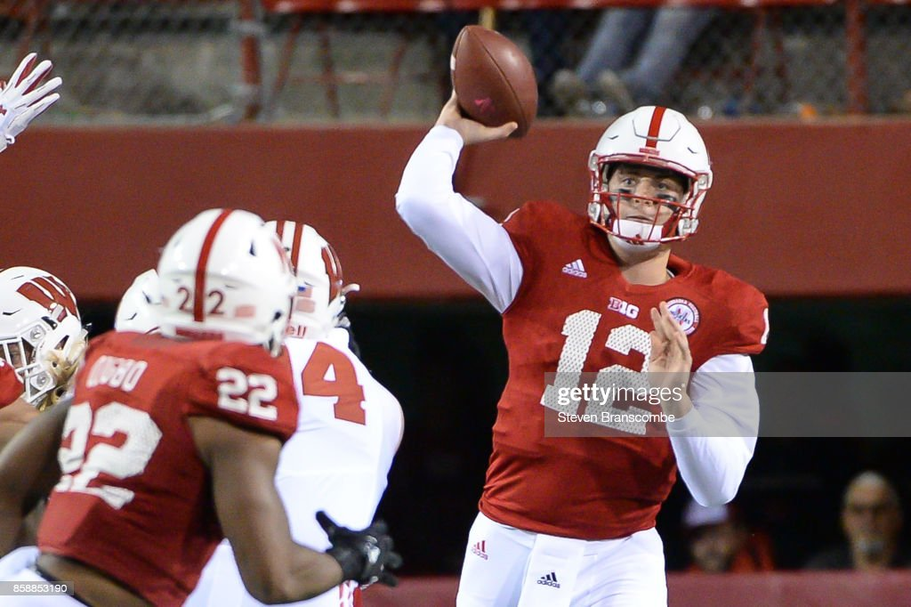 Quarterback Patrick O'Brien #12 of the Nebraska Cornhuskers passes to running back Devine Ozigbo #22 against the Wisconsin Badgers at Memorial Stadium on October 7, 2017 in Lincoln, Nebraska.