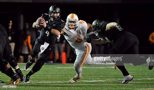 Quarterback Patton Robinette of the Vanderbilt Commoroders is pressured by Derek Barnett of the Tennessee Volunteers during the second half of a game...