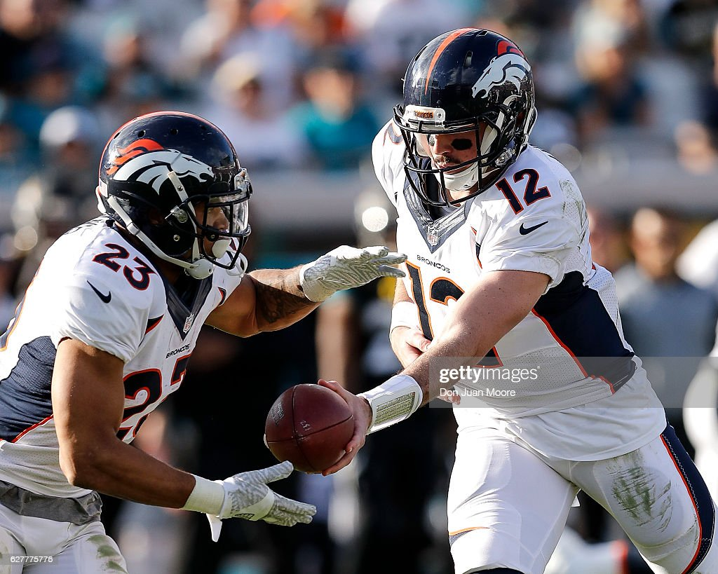 Quarterback Paxton Lynch #12 hands off to Runningback Devontae Booker #23 of the Denver Broncos during the game against the Jacksonville Jaguars at EverBank Field on December 4, 2016 in Jacksonville, Florida. The Broncos defeated the Jaguars 20 to 10.