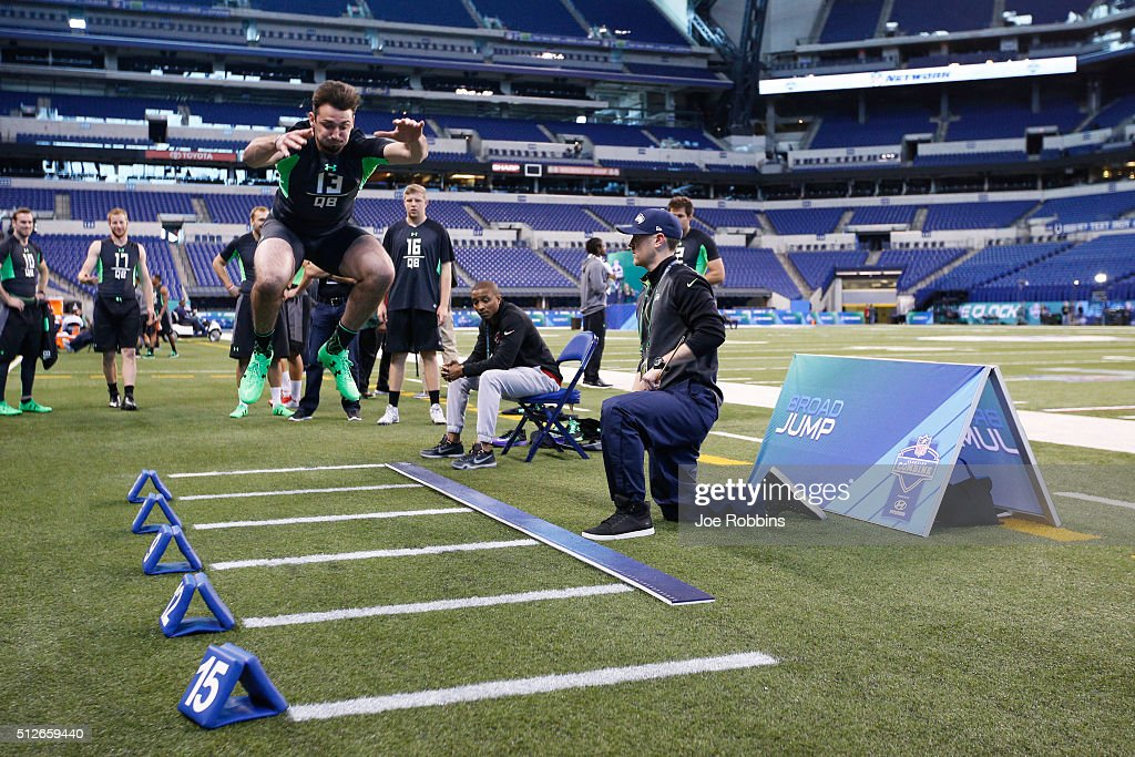 Quarterback Paxton Lynch of Memphis participates in the broad jump during the 2016 NFL Scouting Combine at Lucas Oil Stadium on February 27 2016 in...