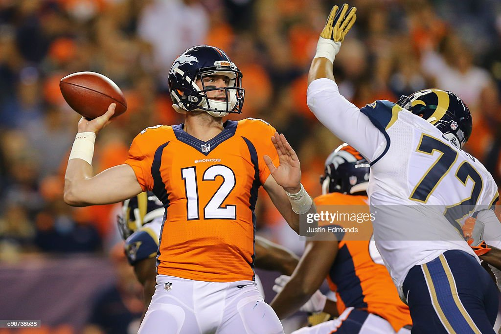 Quarterback Paxton Lynch #12 of the Denver Broncos completes a pass over the outstretched arm of defensive end Ian Seau #72 of the Los Angeles Rams during the fourth quarter at Sports Authority Field at Mile High on August 27, 2016 in Denver, Colorado. The Broncos defeated the Rams 17-9 in pre-season action.