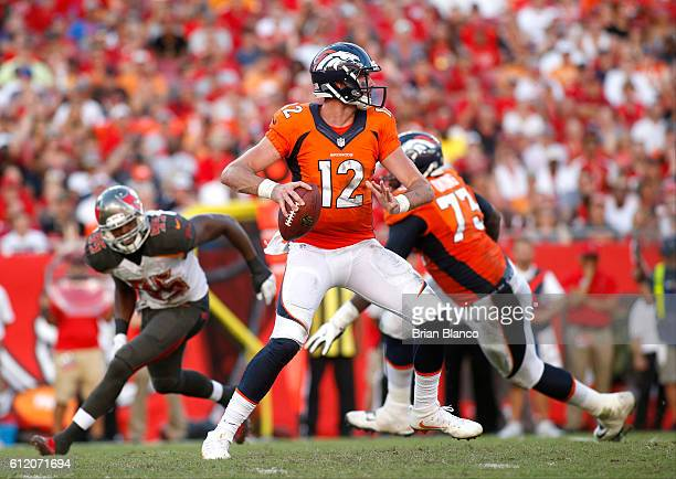 Quarterback Paxton Lynch of the Denver Broncos looks for an open receiver during the third quarter of an NFL game against the Tampa Bay Buccaneers on...