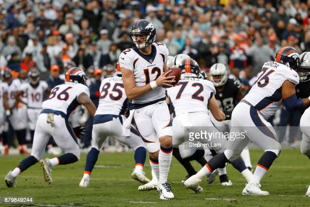 Quarterback Paxton Lynch of the Denver Broncos looks to pass the ball during the first quarter his NFL football game at OaklandAlameda County...