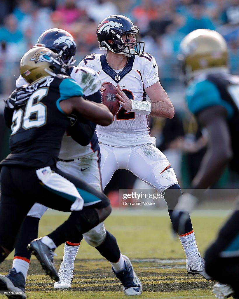 Quarterback Paxton Lynch #12 of the Denver Broncos on a pass play during the game against the Jacksonville Jaguars at EverBank Field on December 4, 2016 in Jacksonville, Florida. The Broncos defeated the Jaguars 20 to 10.