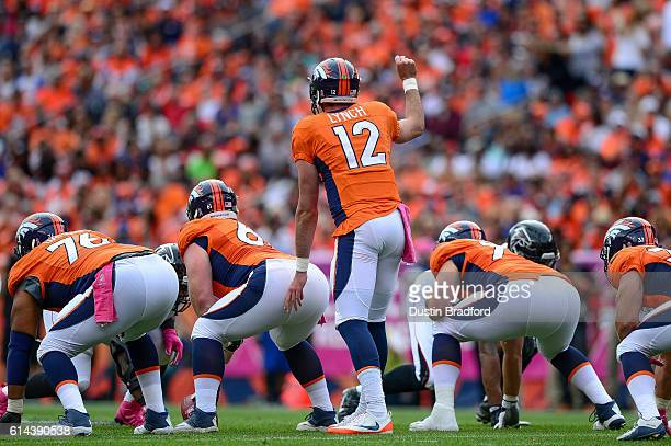Quarterback Paxton Lynch of the Denver Broncos runs the offense against the Atlanta Falcons at Sports Authority Field at Mile High on October 9 2016...