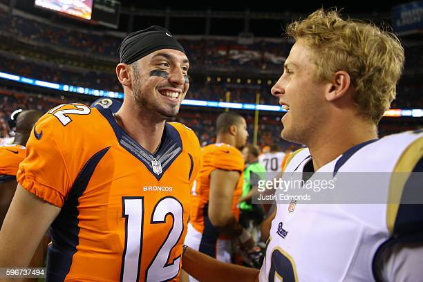Quarterback Paxton Lynch of the Denver Broncos shares a laugh with quarterback Jared Goff of the Los Angeles Rams after their game at Sports...
