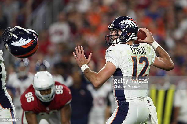 Quarterback Paxton Lynch of the Denver Broncos throws a pass during the preseaon NFL game against the Arizona Cardinals at the University of Phoenix...