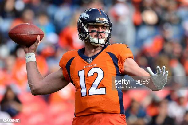 Quarterback Paxton Lynch of the Denver Broncos throws as he warms up before a game against the Cincinnati Bengals at Sports Authority Field at Mile...