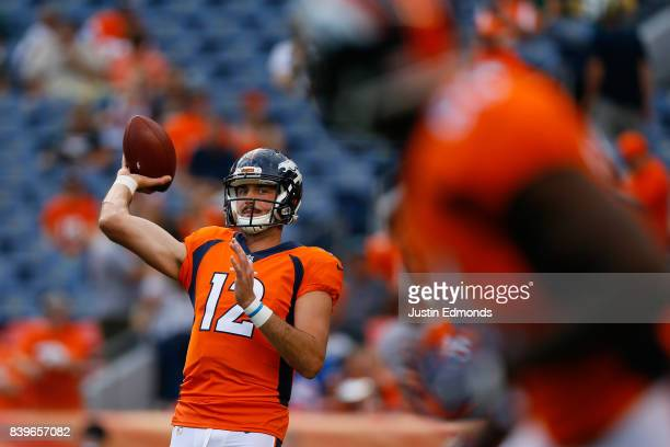 Quarterback Paxton Lynch of the Denver Broncos warms up before a Preseason game against the Green Bay Packers at Sports Authority Field at Mile High...