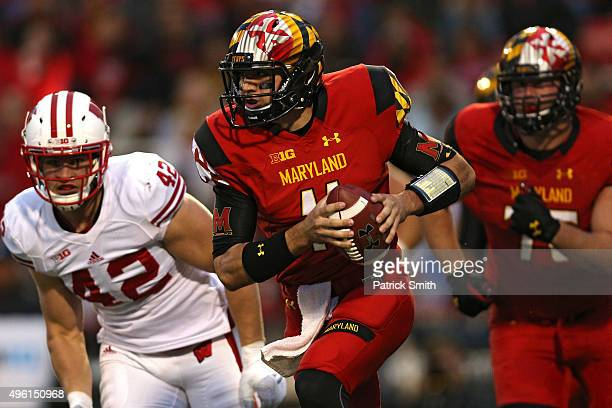 Quarterback Perry Hills of the Maryland rushes past TJ Watt of the Wisconsin Badgers during the first half at Byrd Stadium on November 7 2015 in...