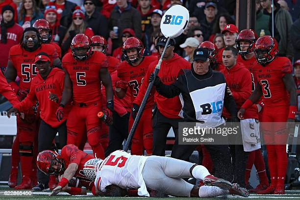 Quarterback Perry Hills of the Maryland Terrapins is tackled by linebacker Raekwon McMillan of the Ohio State Buckeyes in the first quarter at...