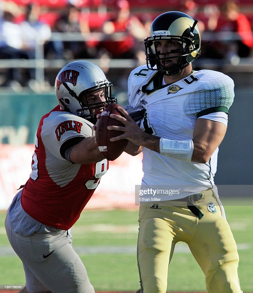 Quarterback <a gi-track='captionPersonalityLinkClicked' href=/galleries/search?phrase=Pete+Thomas&family=editorial&specificpeople=4598308 ng-click='$event.stopPropagation()'>Pete Thomas</a> #4 of the Colorado State Rams escapes a tackle from Alex Klorman #95 of the UNLV Rebels at Sam Boyd Stadium October 29, 2011 in Las Vegas, Nevada. UNLV won 38-35.