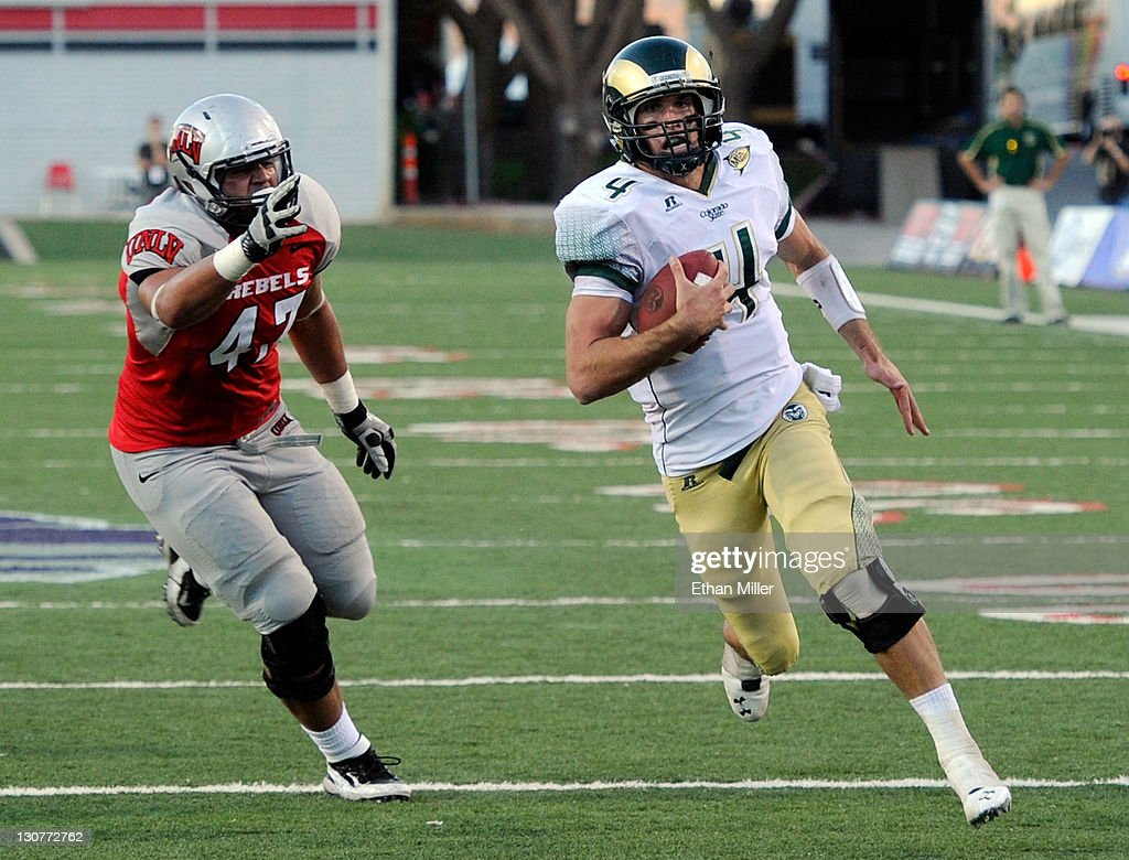Quarterback <a gi-track='captionPersonalityLinkClicked' href=/galleries/search?phrase=Pete+Thomas&family=editorial&specificpeople=4598308 ng-click='$event.stopPropagation()'>Pete Thomas</a> #4 of the Colorado State Rams rushes for a touchdown ahead of Trent Allmang-Wilder #47 of the UNLV Rebels during their game at Sam Boyd Stadium October 29, 2011 in Las Vegas, Nevada. UNLV won 38-35.
