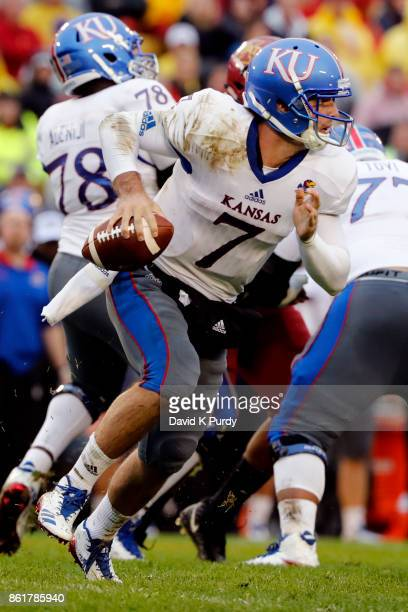 Quarterback Peyton Bender of the Kansas Jayhawks looks for a receiver down field in the first half of play at Jack Trice Stadium on October 14 2017...