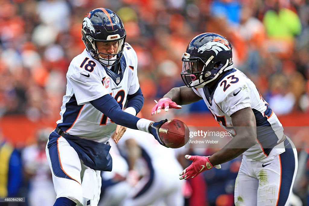 Quarterback Peyton Manning hands the ball of to running back Ronnie Hillman of the Denver Broncos during the fourth quarter against the Cleveland...