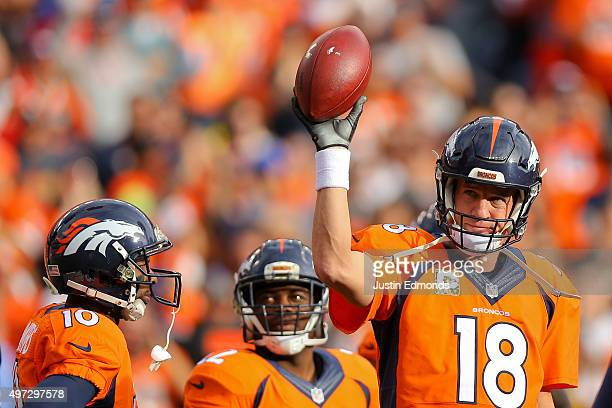 Quarterback Peyton Manning of the Denver Broncos acknowledges the crowd after completing a pass for 4yards to pass the all time career passing yards...