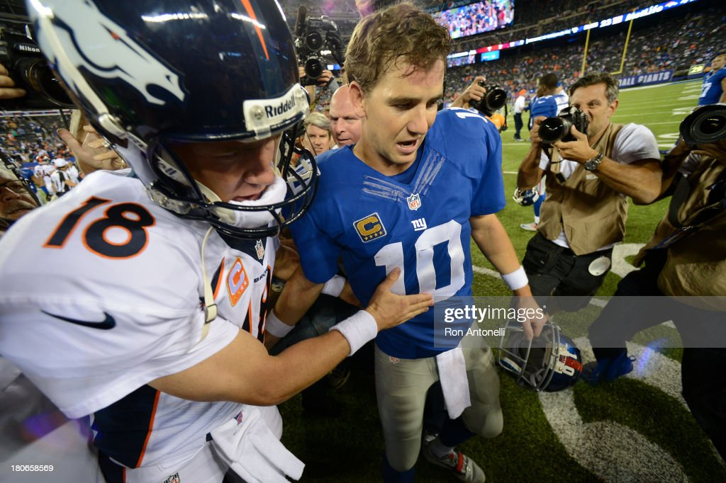 Quarterback <a gi-track='captionPersonalityLinkClicked' href=/galleries/search?phrase=Peyton+Manning&family=editorial&specificpeople=184524 ng-click='$event.stopPropagation()'>Peyton Manning</a> #18 of the Denver Broncos and brother quarterback <a gi-track='captionPersonalityLinkClicked' href=/galleries/search?phrase=Eli+Manning&family=editorial&specificpeople=202013 ng-click='$event.stopPropagation()'>Eli Manning</a> #10 of the New York Giants shake hands at the end of the Denver Broncos 41-23 win over the New York Giants at MetLife Stadium on September 15, 2013 in East Rutherford, New Jersey.
