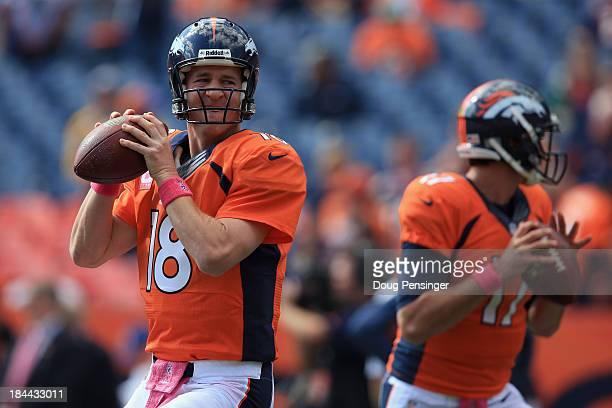 Quarterback Peyton Manning of the Denver Broncos and quarterback Brock Osweiler of the Denver Broncos warm up prior to facing the Jacksonville...