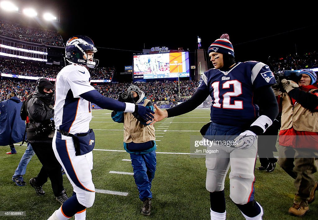 Quarterback Peyton Manning #18 of the Denver Broncos and quarterback Tom Brady #12 of the New England Patriots shake hands after the New England Patriots defeated the Denver Broncos 34-31 in overtime at Gillette Stadium on November 24, 2013 in Foxboro, Massachusetts.