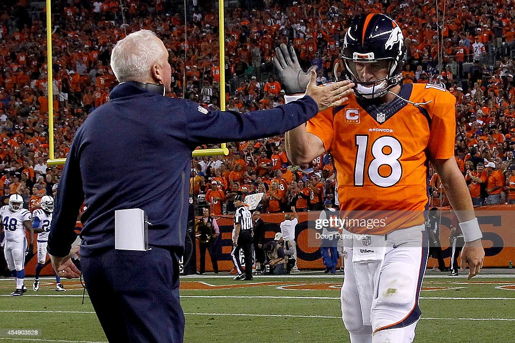 Quarterback <a gi-track='captionPersonalityLinkClicked' href=/galleries/search?phrase=Peyton+Manning&family=editorial&specificpeople=184524 ng-click='$event.stopPropagation()'>Peyton Manning</a> #18 of the Denver Broncos celebrates his five yard touchdown pass to tight end Julius Thomas #80 with head coach <a gi-track='captionPersonalityLinkClicked' href=/galleries/search?phrase=John+Fox+-+Coach&family=editorial&specificpeople=206657 ng-click='$event.stopPropagation()'>John Fox</a> of the Denver Broncos to take a 24-0 lead over the Indianapolis Colts in the second quarter at Sports Authority Field at Mile High on September 7, 2014 in Denver, Colorado.