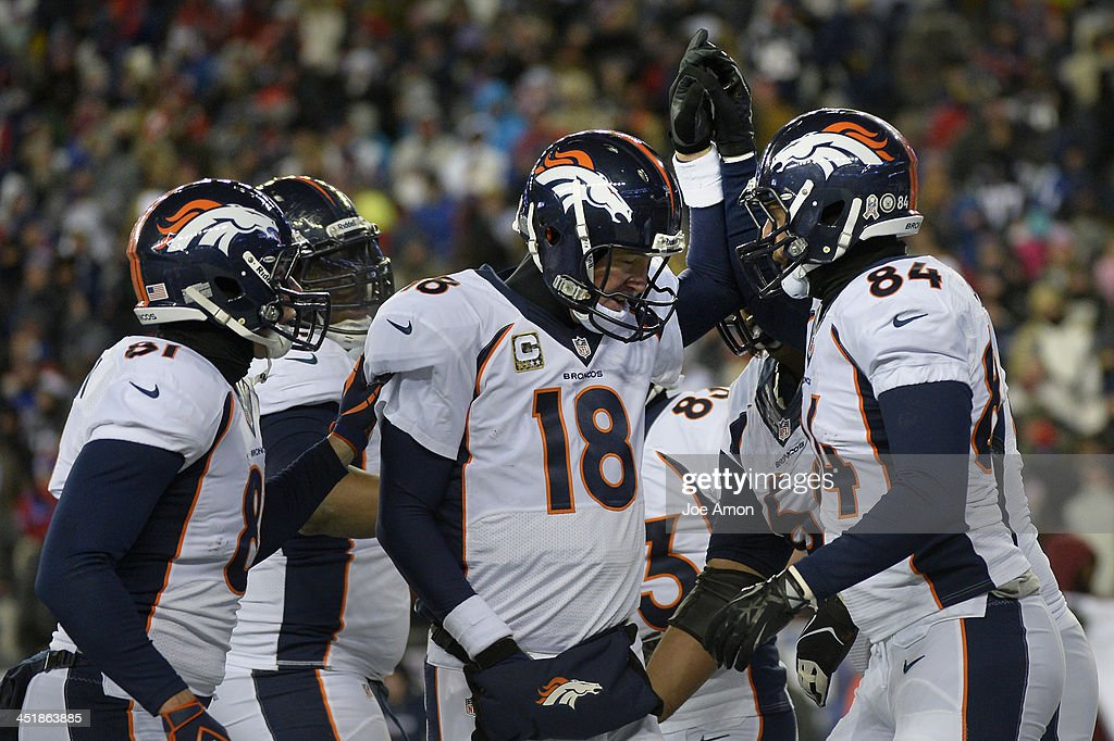 Quarterback Peyton Manning #18 of the Denver Broncos celebrates with tight end Jacob Tamme #84 after he pulled in a touchdown pass vs the New England Patriots at Gillette Stadium in Foxborough MA, November 24, 2013 Denver.