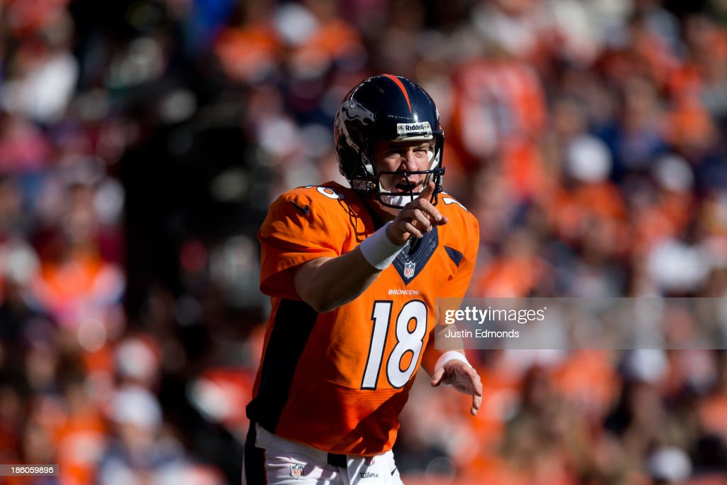 Quarterback <a gi-track='captionPersonalityLinkClicked' href=/galleries/search?phrase=Peyton+Manning&family=editorial&specificpeople=184524 ng-click='$event.stopPropagation()'>Peyton Manning</a> #18 of the Denver Broncos changes the play during a game against the Washington Redskins at Sports Authority Field Field at Mile High on October 27, 2013 in Denver, Colorado.