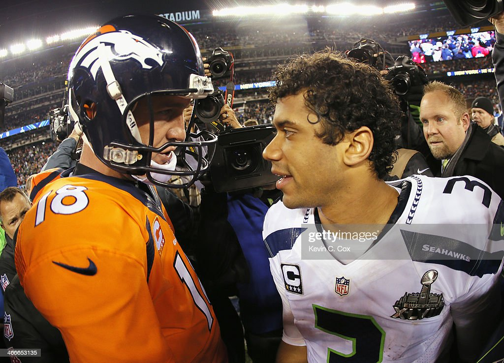 Quarterback <a gi-track='captionPersonalityLinkClicked' href=/galleries/search?phrase=Peyton+Manning&family=editorial&specificpeople=184524 ng-click='$event.stopPropagation()'>Peyton Manning</a> #18 of the Denver Broncos congratulates quarterback <a gi-track='captionPersonalityLinkClicked' href=/galleries/search?phrase=Russell+Wilson+-+American+Football+Quarterback&family=editorial&specificpeople=2292912 ng-click='$event.stopPropagation()'>Russell Wilson</a> #3 of the Seattle Seahawks on their 43-8 win during Super Bowl XLVIII at MetLife Stadium on February 2, 2014 in East Rutherford, New Jersey.