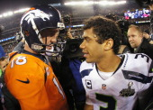 Quarterback Peyton Manning of the Denver Broncos congratulates quarterback Russell Wilson of the Seattle Seahawks on their 438 win during Super Bowl...