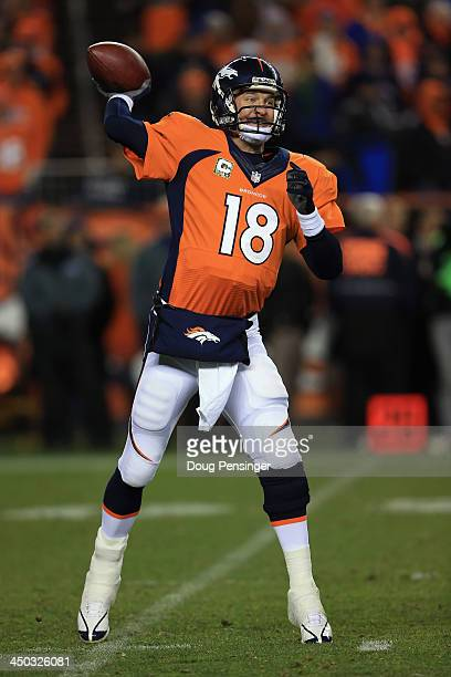 Quarterback Peyton Manning of the Denver Broncos delivers a pass against the Kansas City Chiefs at Sports Authority Field at Mile High on November 17...