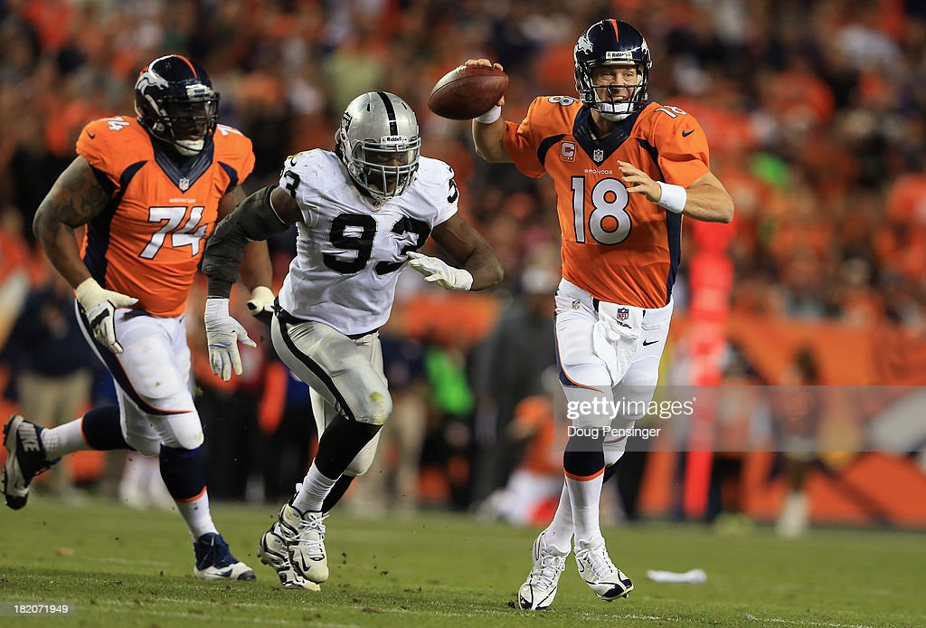 Quarterback <a gi-track='captionPersonalityLinkClicked' href=/galleries/search?phrase=Peyton+Manning&family=editorial&specificpeople=184524 ng-click='$event.stopPropagation()'>Peyton Manning</a> #18 of the Denver Broncos delivers while under pursuit from Jason Hunter #93 of the Oakland Raiders and <a gi-track='captionPersonalityLinkClicked' href=/galleries/search?phrase=Orlando+Franklin&family=editorial&specificpeople=5512610 ng-click='$event.stopPropagation()'>Orlando Franklin</a> #74 of the Denver Broncos follows the play at Sports Authority Field at Mile High on September 23, 2013 in Denver, Colorado.