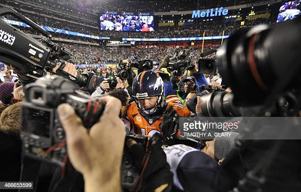 Quarterback Peyton Manning of the Denver Broncos departs the field following their 438 loss to the Seattle Seahawks in Super Bowl 48 at MetLife...