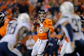 Quarterback Peyton Manning of the Denver Broncos drops back to pass against the San Diego Chargers during a game at Sports Authority Field at Mile...