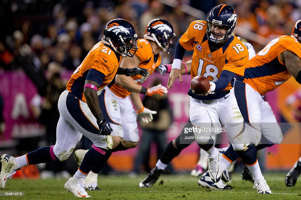 Quarterback <a gi-track='captionPersonalityLinkClicked' href=/galleries/search?phrase=Peyton+Manning&family=editorial&specificpeople=184524 ng-click='$event.stopPropagation()'>Peyton Manning</a> #18 of the Denver Broncos hands the ball off to Running back Ronnie Hillman #21 during the fourth quarter against the New Orleans Saints at Sports Authority Field Field at Mile High on October 28, 2012 in Denver, Colorado. The Broncos defeated the Saints 34-14.