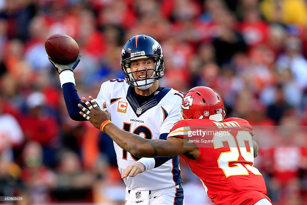 Quarterback <a gi-track='captionPersonalityLinkClicked' href=/galleries/search?phrase=Peyton+Manning&family=editorial&specificpeople=184524 ng-click='$event.stopPropagation()'>Peyton Manning</a> #18 of the Denver Broncos is forced to throw the ball away as he is hurried by strong safety <a gi-track='captionPersonalityLinkClicked' href=/galleries/search?phrase=Eric+Berry+-+American+Football+Player&family=editorial&specificpeople=4501099 ng-click='$event.stopPropagation()'>Eric Berry</a> #29 of the Kansas City Chiefs during the game at Arrowhead Stadium on December 1, 2013 in Kansas City, Missouri.
